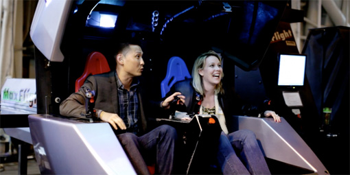 Marketers experience flight simulators aboard an aircraft carrier.