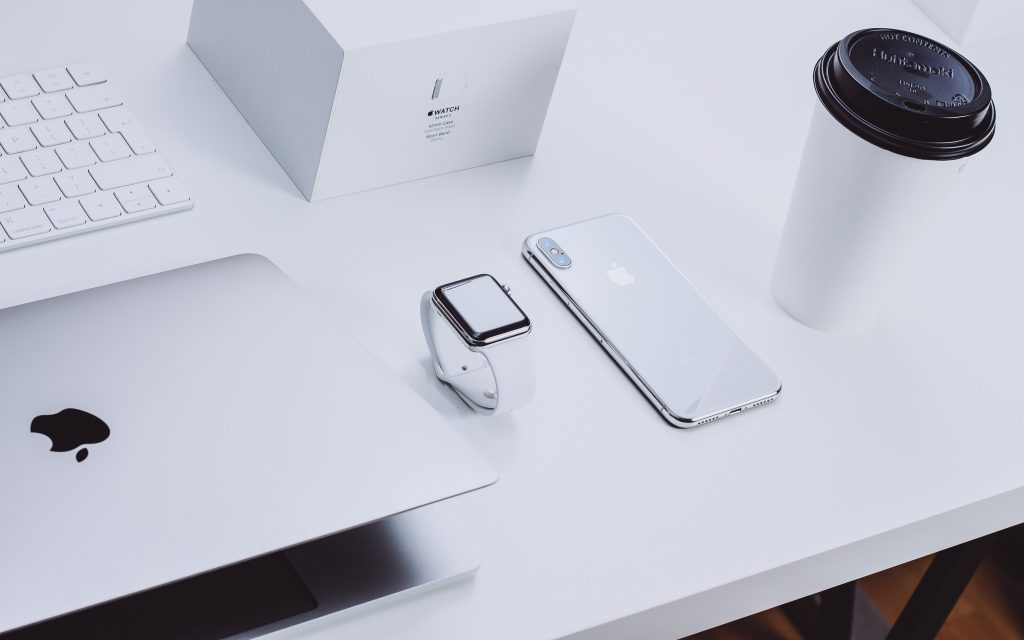 Apple products on a desk.
